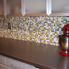 Yellow and Gray mosaic tile for the kitchen.  Small enough yellow not to overwhelm and can still use blue/gray if desired for color scheme.