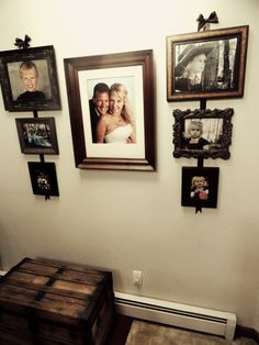 family wall decor | Family Photo Wall - Picture Placement | Decor & More I like the rustic feel of the colors and having a wedding picture centered between children. I think i would change side frames up a bit