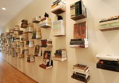 Hallway. Home Decor. Floating bookshelves. Invisible Bookshelves. Book Display. Shelves available @ http://www.smartfurniture.com/products/Conceal-Floating-Bookshelves.html $13.50 each. (I really want to do this one day!!!)