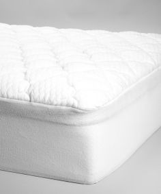Providing comfort and protection, this plush mattress topper was designed with a luxuriously smooth cool-touch Tencel top layer and a waterproof barrier below. A SureGrip skirt offers a snug fit so it's certain to stay in place throughout the night.Available in multiple sizesPolyesterMachine wash