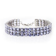 Have you ever seen a color so serene and beautiful? We think no. Pair this bracelet with a crisp white pant and pastel top for a sweet summer glow.   30.00ctw Oval Tanzanite Sterling Silver Bracelet