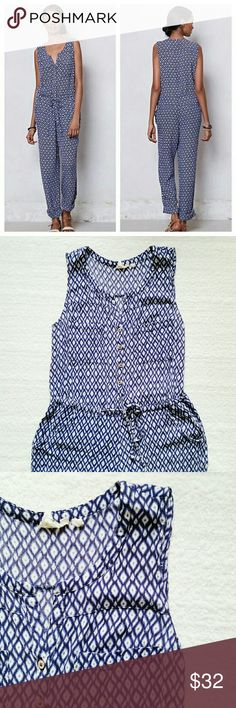 Lilka dao ikat jumpsuit Cotton jumpsuit with drawstring waist and cute wooden button front. Pant legs roll up and button. Back welt pockets.  In good condition. There was a tear in the crotch area that has been repaired and cannot be seen when worn. Anthropologie Pants Jumpsuits & Rompers
