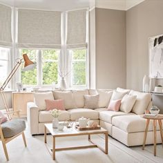 Pale and pretty living room with copper floor lamp