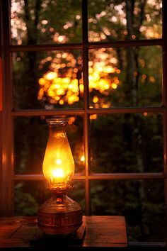 the cozy glow of an oil lamp Window View, Through The Window, Candle Lanterns, Cabins In The Woods, Oil Lamps, Belle Photo, Glow, Windows, Warm
