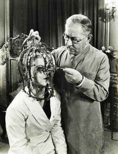 """In Max Factor demonstrates his """"scientific device"""", the Beauty Micrometer, which detects defects in feminine beauty that are imperceptible to the naked eye. This medical wonder may not have worked but it did help Max Factor build a beauty empire. Max Factor, Vintage Medical, Bizarre, Ex Machina, Ansel Adams, Weird And Wonderful, Vintage Photographs, Vintage Images, Vintage Beauty"""