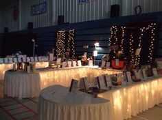 Layout for Cafe? Underlighting on auction table - really like this display for silent auction.since we're going to have the big room this year, this might work well Auction Items, Art Auction, Silent Auction Baskets, Fundraising Events, Fundraising Ideas, Fundraiser Themes, Raffle Baskets, Gift Baskets, Auction Projects