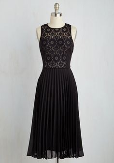 Heighten your chances of meeting The One by swaying into this mid-length LBD to the soiree. Displayed between princess seams, a gorgeous floral lace panel flaunts femininity, while a beige-lined illusion neckline, back keyhole, and pleated skirt garner glimpses from the classiest partygoers!