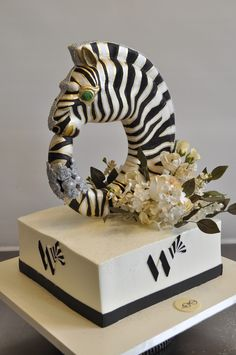 Sylvia Weinstock Cakes. God. My daughter is really into Zebras right now. She'll be asking for this for her bday this year. I can hear it now. Mine as well start getting some ideas on the theme and everything. The blonde in the pic.