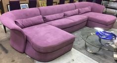 FUN MODERN SECTIONAL SOFA WITH TWO CHAISE ENDS, IN A SOFT ORCHID HUE. INCLUDES FOUR LOWER BACK PILLOWS THAT ATTACH BY WAY OF ZIPPER AND/OR VELCRO. SOFA SHOWS GENTLE SIGNS OF WEAR. 32H X 160W X 65D