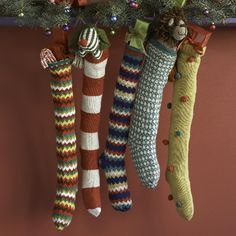 Want some stockings like these....but they don't really match my Christmas decor.