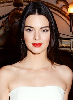Kendall Jenner wears a clean, classic makeup complete with a velvety, true red lipstick.