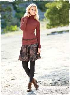 Las Rosas Skirt   Abloom with watercolor roses in dusky shades of russet and indigo, the flippy short viscose skirt flares out from a wide, flat yoke.