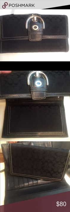 Coach black trifold wallet with checkbook cover This is a wonderful piece in excellent used condition. This has only been used a handful of times and has spent the majority of its life in the closet. It's time for this piece to get out into the world and give someone some joy! There are no rips, tears or stains and all pieces of the original wallet are intact. Coach Bags Wallets