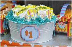 Carnival... I like these as prize containers. Have a letter or number on each one to correspond with what they won. (Numbers on the bottom of ducks, behind popped balloons, etc.)