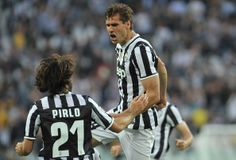Fernando Lorente (R) of Juventus celebrates his second goal during the Serie A match between Juventus and AS Livorno Calcio at Juventus Aren...