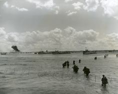June 6, 1944: Army troops wade ashore, to invasion beachhead along the northern French coast, D-Day.  Official U.S. Navy Photograph. PR 076, WWII Photograph Collection, New-York Historical Society, 85735d.