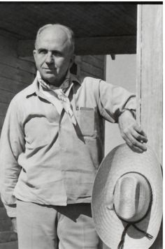 james a michener photos | James A. Michener, with scarf around his neck, straw…