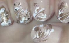 White and gold marble nail art