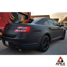 Ford Taurus completely transformed with a wrap in 3M Matte Deep Black by Apex Customs, apexcustoms.com