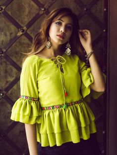 Lime Green Ruffled Top From The House Of Chimerical. Its A Lime Green Top With Ruffled Waist Line And Sleeves With Hand Emroidered Lace And Tassels Detailing. The Color Is Lime Green. Stylish Dresses For Girls, Stylish Dress Designs, Designs For Dresses, Western Dresses For Women, Trendy Outfits, Designer Party Wear Dresses, Kurti Designs Party Wear, Indian Designer Outfits, Designer Wear