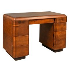 1940's Paul Goldman Bent Plywood Desk for Plymold Corp | From a unique collection of antique and modern desks at https://www.1stdibs.com/furniture/storage-case-pieces/desks/