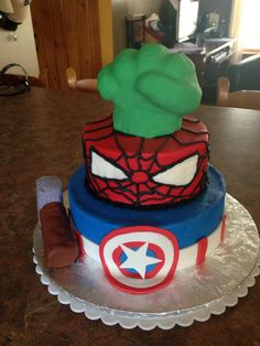 Avenger themed cake. Rice Krispies were used for the Hulk fist and Thor's hammer.