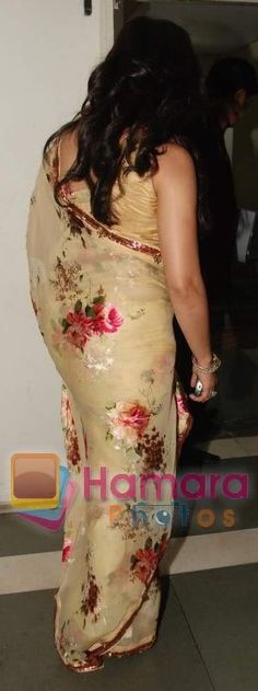 Mahima's shows us her lovely butt in a floral saree.