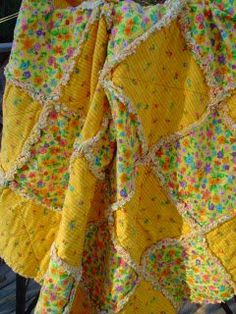 Cute rag quilts are great ideas for quick baby girl quilts or baby boy quilts. The Sunny Baby Rag Quilt made with bright yellow prints is an adorable quilt for either gender. Put together this snuggly rag quilt in just a few hours! Baby Rag Quilts, Boy Quilts, Girls Quilts, Flannel Rag Quilts, Quilting Tutorials, Quilting Projects, Sewing Projects, Sewing Ideas, Quilting Tips