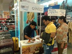 Hiland's Riverfront & Ganges Promotions - A customer showing interest in the brochure of Riverfront and Ganges .