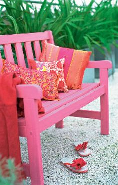 Painting up a timber bench is one of the easiest ways to inject colour into a garden.