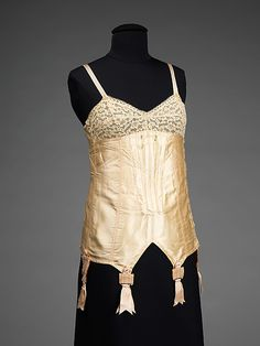 Corselet Au Grand Chic Date: ca. 1925 Culture: French Medium: silk, elastic, bone Dimensions: Length at CB: 22 1/2 in. (57.2 cm) Credit Line: Brooklyn Museum Costume Collection at The Metropolitan Museum of Art, Gift of the Brooklyn Museum, 2009; Gift of Mrs. Frederick H. Prince, Jr., 1967 Accession Number: 2009.300.2891a–g