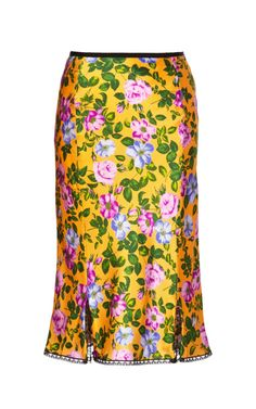 When I was a teen I had the most beautiful yellow sun dress. This beautiful skirt reminds me of it: Floral Printed Silk-Satin Skirt by Nina Ricci