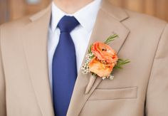 Orange boutonniere // Loft Photographie // http://blog.theknot.com/2013/09/23/the-cutest-page-boy-ring-bearers-in-texas-hill-country/