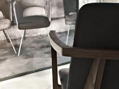 The rigorous design by Piero Lissoni creates a linear yet warm-looking seat. A product able to adapt to any furnishing Take A Seat, Home Collections, Soft Fabrics, Highlight, Minimalism, Armchair, Dining Chairs, Detail, Furniture