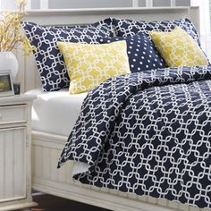 Navy Metro Bedding Set. Classic bedroom style, shown here with yellow metro and navy ikat dots accent pillows. All of American Made Dorm and Home's bedding is made in the USA enabling us to ensure the quality and craftsmanship of our products. Find it all at www.amdorm.com #madeinUSA #DormLife #AmericanMadeDorm