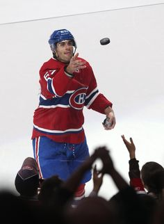 CrowdCam Hot Shot: Montreal Canadiens left wing Max Pacioretty gives away a puck as he is named first star of the game against New Jersey Devils at the Bell Centre. Photo by Jean Montreal Canadiens, Max Pacioretty, New Jersey Devils, Left Wing, Hockey Players, Jets, Nhl, Team Logo, Centre