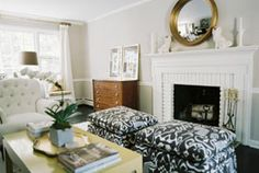 i like everything about this..double ottomans, gold black white, vintage dresser..Lonny Mag