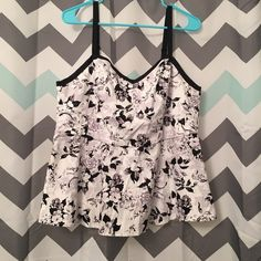 Torrid Black & White Floral Peplum Size 0X Torrid Black & White Floral Peplum Size 0X. Comes from a smoke free home, let me know if you have any questions! torrid Tops Tank Tops