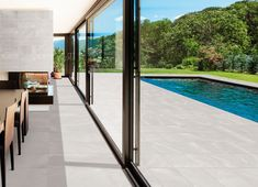 Summertime and the living is fabulous! You don't need a fancy vacation in exotic places to enjoy summer, bring those summer vibes home with a beautifully tiled patio! Trend-forward stone-look tiles are ideal for creating a seamless indoor outdoor space. #summer #patiolife #patioliving #livingwell #home #dreamhome #outdoorspaces #tiles #patiotiles #outdoortiles