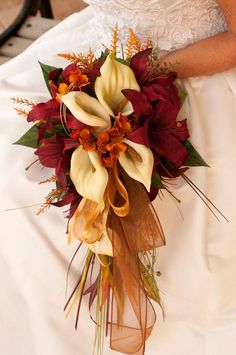 How romantic are these warm fall wedding colors? We adore this wedding bouquet. Featured Bouquet: ISLANDBRIDALCOMPANY via Etsy - use a tartan ribbon instead of the organza. Lys Calla, Calla Lily, Wedding Bridesmaid Bouquets, Bride Bouquets, Bridesmaid Ideas, Fall Wedding Flowers, Fall Flowers, Orange Flowers, Orange Wedding Flower Arrangements
