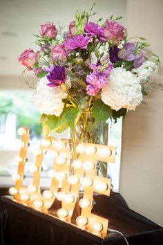 Our love sign with the couple's arrangement in our reception room at  Heather's Glen. Jessica Pledger Photography