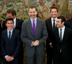 King Felipe VI of Spain (C) receives the motorcycling world champions in 2014 (L-R) Marc Marquez Alenta, MotoGP champion and Toni Bou, Trial champion at Zarzuela Palace on November 20, 2014 in Madrid, Spain
