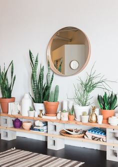 """We have a somewhat large open space that is very undefined…I wanted some kind of wall shelf but nothing that took away from the airy open feel so I made a makeshift shelf out of pieces of douglas fir and cement blocks. I love how it looks clean and modern but also like it could be from out back in the garage."""