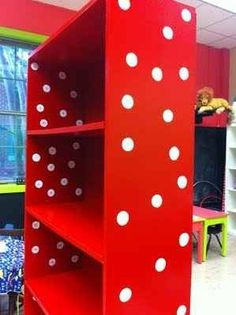 Simple white circle stickers turns a boring bookcase into something out of a Dr. Seuss book.