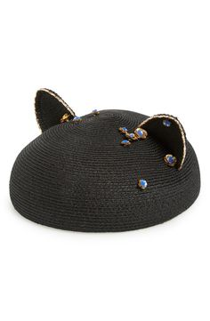 This chic beret fashioned from hemp straw is topped with cute cat ears with golden trim and hand-beaded blue and gold rosettes.