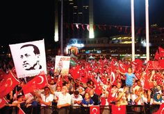 SUPPORTERS OF Turkish President Recep Tayyip Erdogan wave national flags in…