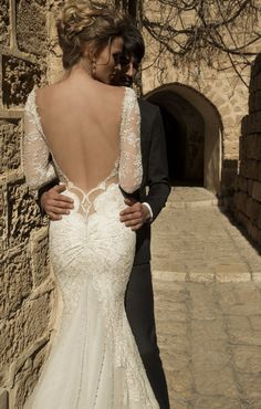 Navona - Shimmering fabric constructed into a mermaid silhouette. Very deep falling neckline and very low naked back.
