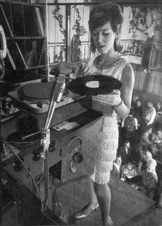 Joanie Labine, the first female DJ at the Whiskey...    Though The Sunset Strip Whisky club was billed as a discothèque, suggesting that it offered only recorded music, the Whisky a Go Go opened with a live band led by Johnny Rivers and a short-skirted Joanie spinning records between sets from a suspended cage at the right of the stage. When, in July 1965, the DJ danced during Rivers' set, the audience thought it was part of the act and the concept of go-go dancers dancing in cages was born.