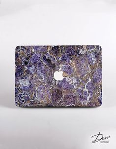 Purple Marble Macbook Case for all MacBook models.  This Purple Marble case designs is a little twist on the so popular and trendy lately marble texture. With a high visual quality this case is a perfect choice if you want to stand out from the crowd with a trendy yet different case.  We use our devices all the time, so why dont you have them protected in a very stylish way?   ABOUT THE CASE  The pictures above are examples of cases for the different options you can have, WITH or WITHOUT…