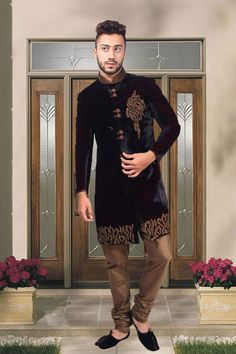 Gorgeous #Black #velvet indo western sherwani in chinese collar & full sleeves along with silk #gold chuddi bottom ideal for #reception.
